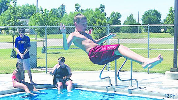 Waiting for the splash, Ty Newell of Greensburg is caught mid-air following his leap from the Greensburg Swimming Pool diving board. The pool is supported by city funding.