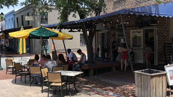 Diners enjoy a meal outside of Wet Willie's in City Market last month. The number of unemployment claims decreased in the Savannah area in May and the leisure and hospitality industry ended the month with 17,500 jobs, an increase of 3,500 compared to April, according to the Georgia Department of Labor.