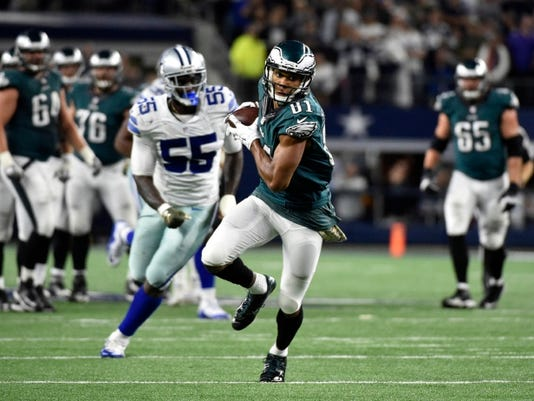 Philadelphia Eagles' Jordan Matthews (81) catches a pass and runs it to the end zone for a touchdown as Dallas Cowboys' Rolando McClain (55) watches in overtime of an NFL football game Sunday, Nov. 8, 2015, in Arlington, Texas. The Eagles won 33-27. (AP Photo/Michael Ainsworth)