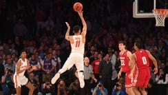 Florida Gators guard Chris Chiozza (11) makes a three