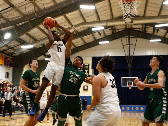 Beacon's Zamere McKenzie goes up for a shot against
