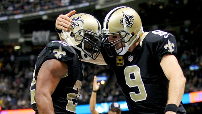 Saints quarterback Drew Brees (9) congratulated running back Mark Ingram (22) after a touchdown against the Packers in the second half at the Superdome on Sunday.