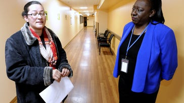 Patient Venessa Raices, left, talks to Western Wayne Family Health Centers CEO Linda Atkins, RN. Raices, of Detroit, came to the Inkster clinic with flu symptoms.