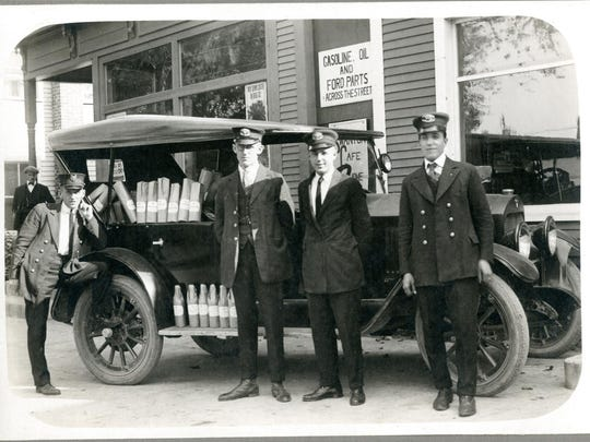 U.S. Customs Officers at the Swanton border crossing pose in 1923 with captured Canadian alcohol.