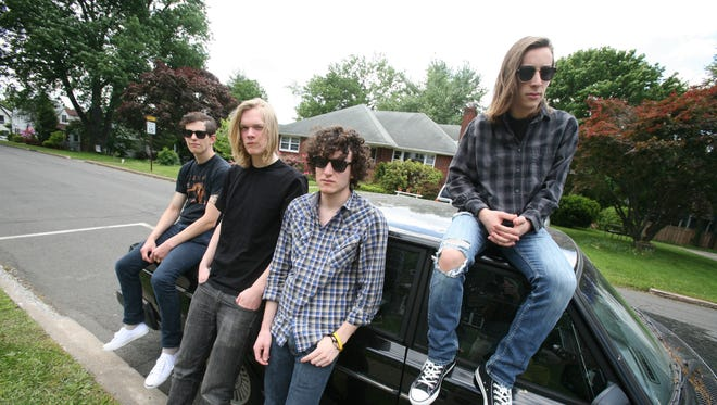 Members of the rock band Regret The Hour, from left Sam Oatts, bass; Anders Fleming, drums; Ben McCarthy, guitar and Nate McCarthy, lead vocal and rhythm guitar, pose for a photo in Nyack, May 31, 2014.