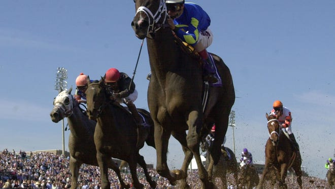 Ashado, top, with jockey John Velazquez cross the finish line Breeders Cup Distaff race in Grand Prairie, Texas, Saturday, Oct. 30, 2004. On the left is thrid place Stellar Jayne with jockey Robby Albarado up and second place finisher Storm Flag Flying with jockey Jerry Bailey up, second from left.  (AP Photo/Al Behman)