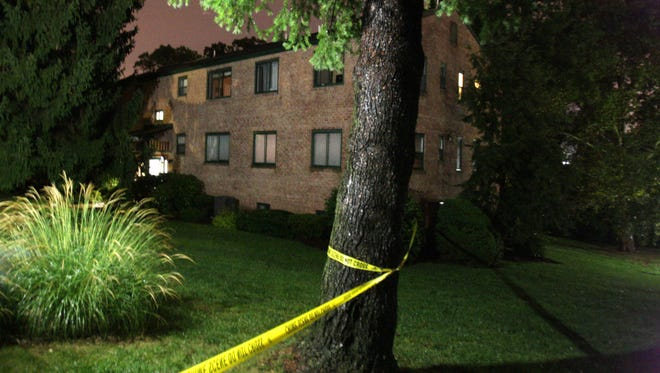 Crime scene tape on Sept. 22, 2013, surrounds the Paladin Drive building in Fox Point where Joseph and Olga Connell were killed. Connell's business partner is accused of orchestrating the crime.