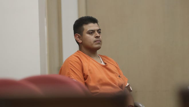 Edwin Lara of Oregon waits in Siskiyou County Superior Court in Yreka, Calif.,  on Friday, July 29, 2016, for his arraignment on attempted murder, kidnapping and other charges in connection to a crime spree last week that started with the death of a woman in Oregon.