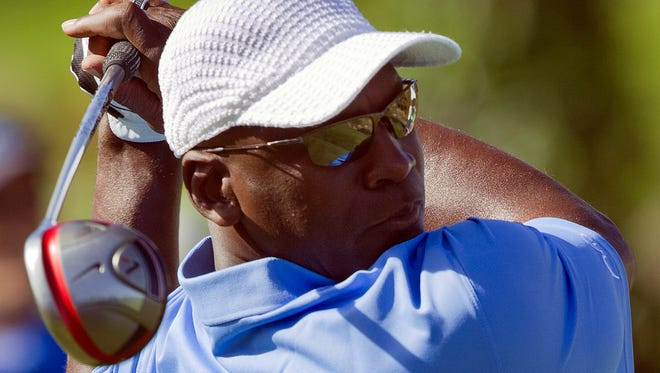 Former basketball player Michael Jordan tees off on the first hole during the Michael Jordan Invitational celebrity golf tournament March 31, 2011, in Las Vegas.