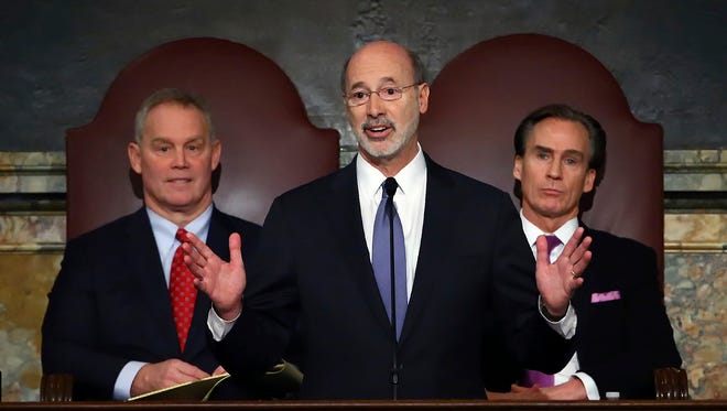In this Feb. 9, 2016, file photo, Gov. Tom Wolf, center, delivers his budget address for the 2016-17 fiscal year to a joint session of the Pennsylvania House and Senate, as the speaker of the state House of Representatives, state Rep. Mike Turzai, R-Allegheny, left, and Lt. Gov. Mike Stack, right, listen at the State Capitol in Harrisburg.