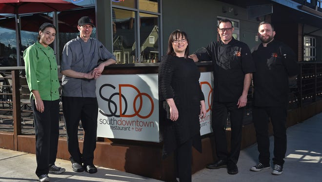 Joel Giandalia, second from right, the founder and former owner of SoDo, takes a recent moment with his staff leads. Giandalia sold the restaurant on March 16, 2017.