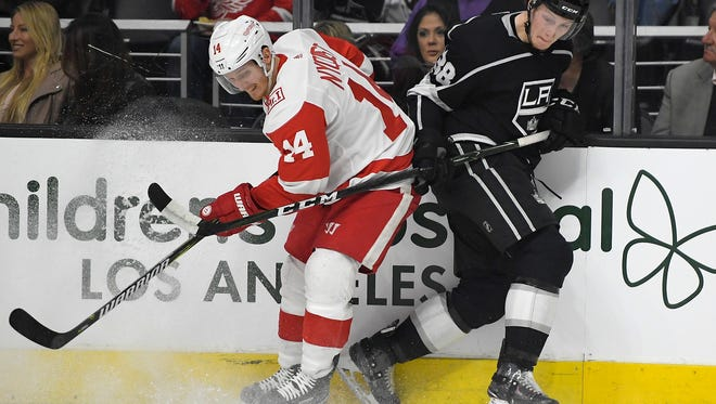 Red Wings right wing Gustav Nyquist and Kings defenseman Paul LaDue battle on the boards during the first period on Thursday, March 15, 2018, in Los Angeles.