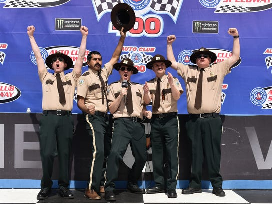 The cast of Super Troopers 2 give the command to fire engines prior to the Monster Energy NASCAR Cup Series Auto Club 400 at Auto Club Speedway on March 18 in Fontana, California.