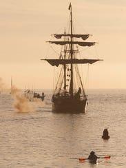 The tall ship Hawaiian Chieftain fires its cannon as