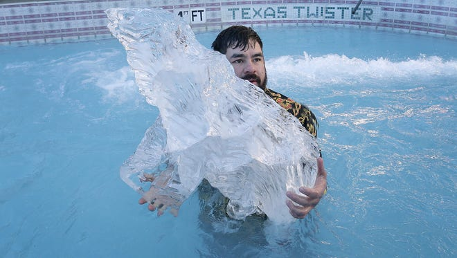 Sergio Moreno held onto the polar bear ice sculpture after taking part in the Polar Plunge, where he flew down the Texas Twister and into the pool at the Wyndham El Paso Airport Hotel. Fifteen El Pasoans took the plunge to raise money for Special Olympics.