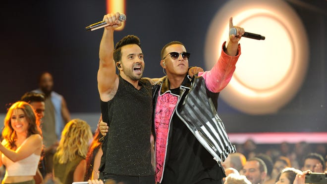 Luis Fonsi and Daddy Yankee perform onstage at the Billboard Latin Music Awards at Watsco Center on April 27, 2017.