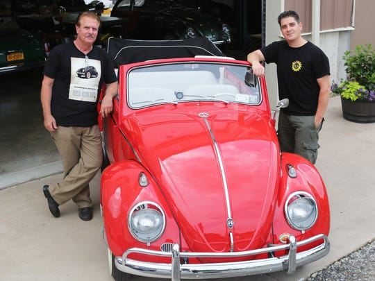 Chris Vallone, 40, owner of Classic VW Bugs, and his father Chris Vallone Sr.,  beside a 1962 Volkswagen Beetle convertible at the shop in Congers July 11, 2017. The younger Vallone started the vintage Volkswagen Beetle restoration business ten years ago.