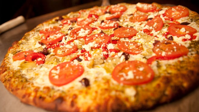 The Roman Candle offers a variety of specialty or build-your-own pizza options, along with salads, baked pastas, and desserts.