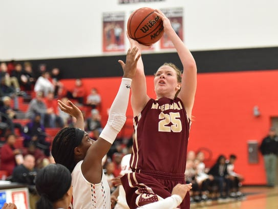Riverdale's Alexis Whittington fires a jumper during
