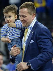 South Dakota State coach T.J. Otzelberger carries his