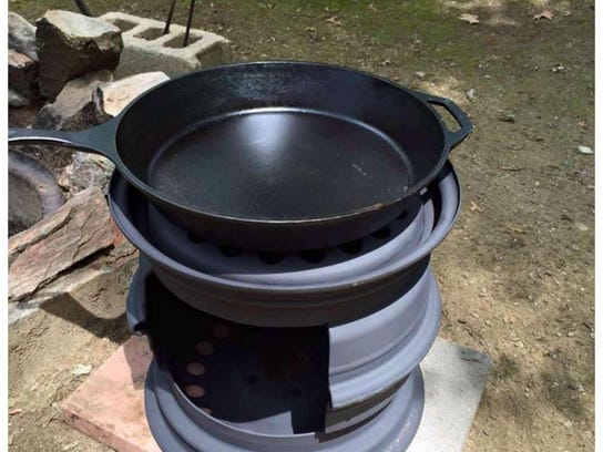 A DIY wood stove made from a tire. Find other ideas