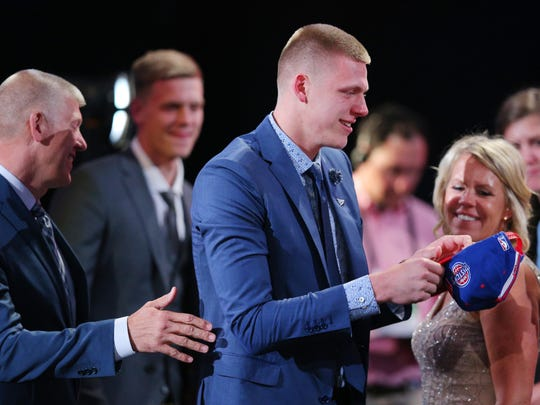 Jun 23, 2016; New York, NY, USA; Henry Ellenson (Marquette) reacts after being selected as the number eighteen overall pick to the Detroit Pistons in the first round of the 2016 NBA Draft at Barclays Center. Mandatory Credit: Brad Penner-USA TODAY Sports ORG XMIT: USATSI-269318 ORIG FILE ID: 20160623_jel_ae5_159.jpg