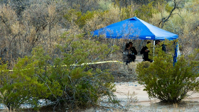 Las Cruces Police tape off more than 50 yards of desert area behind Walmart on Rinconada Boulevard as they investigate the location on Sunday, December 10, 2017, after a person walking a dog found human remains there.