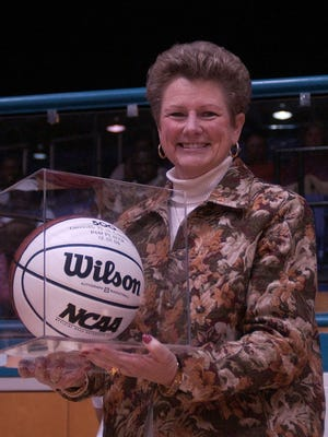 Pam Player, pictured with a ball celebrating her 500th victory, is a member of the South Carolina Basketball Coaches Association's Hall of Fame Class of 2018.