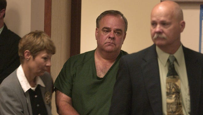 Gerald Carnahan is led into the courtroom for his arraignment in the 1985 murder of Jackie Johns. Photo from Aug. 10, 2007