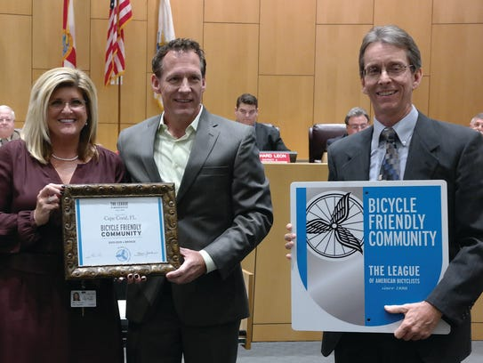 From left: Cape Coral City Manager John Szerlag;