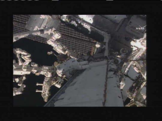 NASA's Scott Kelly and Tim Kopra perform a spacewalk
