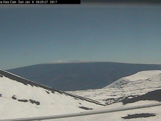 Snow covers the peak of the Mauna Kea volcano in Hawaii