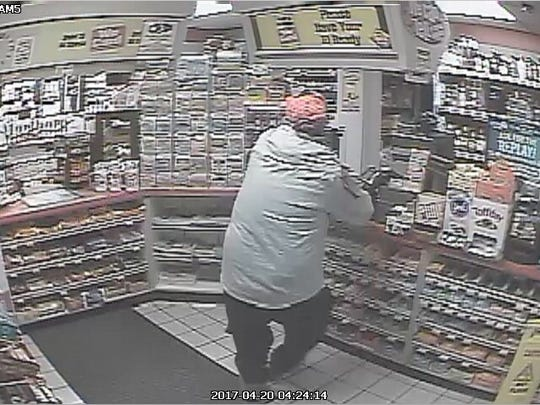 A surveillance photo shows the suspect in an armed robbery at the Valero gas station in Lexington.
