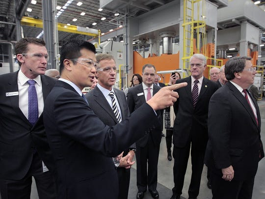In 2014, Electrolux Plant Manager George Robbins (left) and President and CEO of Electrolux Major Appliances North America Jack Truong give then-Tennessee Gov. Bill Haslam (third from left) a tour of the newly opened Electrolux plant.