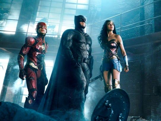 "The Flash (Ezra Miller, from left), Batman (Ben Affleck) and Wonder Woman (Gal Gadot) assemble in ""Justice League."""
