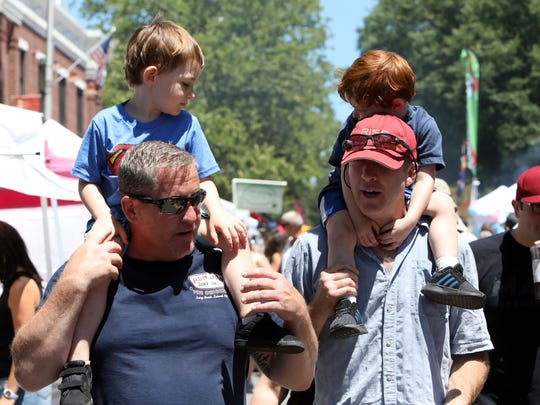 Families walk through the Nyack Famous Street Fair in downtown Nyack July 8, 2018.