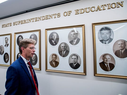 Incoming State Superintendent Eric Mackey walks past photos of previous superintendents in Montgomery, Ala., on Friday morning May 11, 2018.