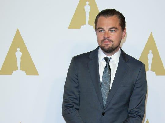 Leonardo DiCaprio takes in the scene at the Oscar Nominees