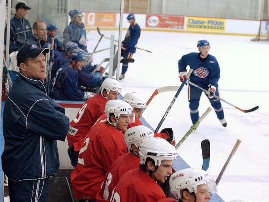 Head Coach Randy Cunneyworth, left, watches his team scrimmage from the bench at the ESL Sports Centre in Brighton in 2005.