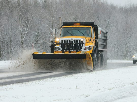 A Brown County snowplow clears the roundabouts at Cty
