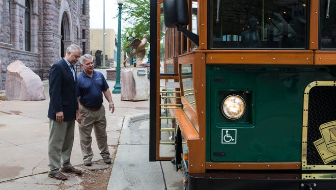 Joe Batcheller, president of Downtown Sioux Falls Inc. (left), and Tom Olson talk to each other about the return of the trolley in downtown Sioux Falls, S.D. on Wednesday, May 30, 2018.