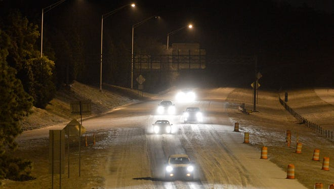 Traffic moves slowly along an icy Interstate 485 at Rea Road, early Tuesday, Feb. 17, 2015, in Charlotte N.C. About a half-inch of ice accumulated overnight topped by a dusting of snow. (The Charlotte Observer, Davie Hinshaw)