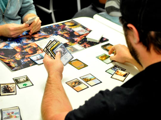 "Two players face off in a game of ""Magic: The Gathering"" at Paddy's Game Shoppe in St. Cloud."