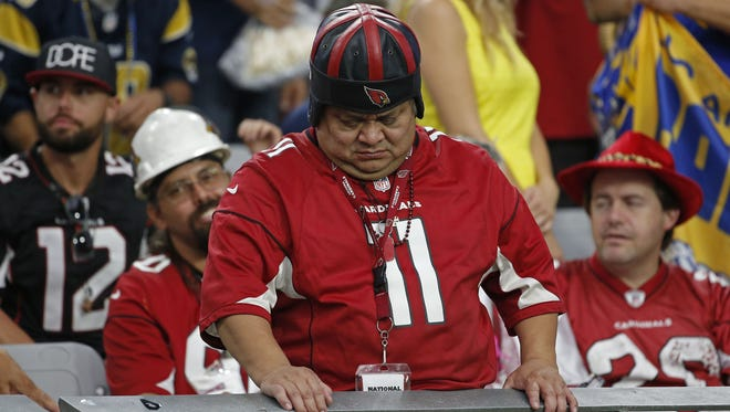 Oscar Hernandez reacts to Drew Stanton's second pick against the Rams during the second half at University of Phoenix Stadium on October 2, 2016 in Glendale, Ariz.