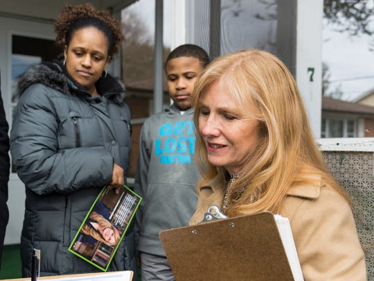Stephanie Hansen speaks with Bronte Garnett and her son, Justin Mowbray, 10, in Middletown as she campaigns for the special election for the state Senate in the Middletown area.