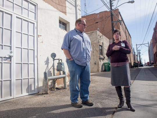Michael Bulloch of the Farmington Downtown Association and Sherry Roach, project coordinator for the city of Farmington's Complete Streets program, are seen on March 19 in an alleyway that is part of the city's public art and lighting project.