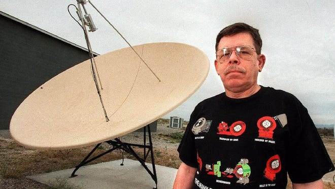 Radio announcer Art Bell is shown in this May 12, 1998, file photo at his home in Pahrump, Nev. Bell, host of America's most popular overnight radio show, gave his final broadcast of that show on Oct. 13, 1998.