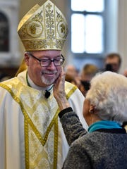 Bishop Christopher Coyne is congratulated by his mother,