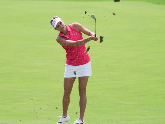 "A ""racer-back"" top like Lexi Thompson often wears is"
