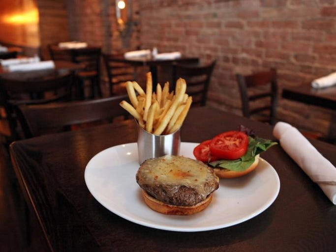 The Mill Burger, with house rub, New York aged cheddar, heirloom tomato and cracked pepper and sea salt fries, is photographed at The Mill, Sept. 12, 2013 in Hastings-on-Hudson. The gastropub offers craft beers and cocktails, and a farm-to-table menu.